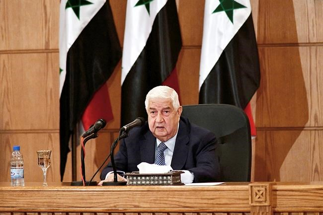 FILE - In this June 23, 2020, file photo, released by the Syrian official news agency SANA, Syrian Foreign Minister Walid al-Moallem speaks during a news conference in Damascus, Syria. Al-Moallem, a career diplomat who became one of the country's most prominent faces to the outside world during the uprising against Syria's President Bashar Assad, died Monday, Nov. 16, 2020. He was 79. (SANA via AP, File)