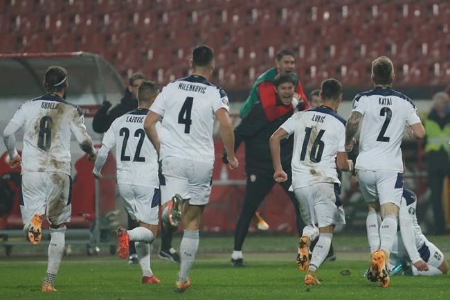 Serbia players celebrate after Luka Jovic scored his side's opening goal during the Euro 2020 playoff final soccer match between Serbia and Scotland, at the Rajko Mitic stadium in Belgrade, Serbia, Thursday, Nov. 12, 2020. (AP Photo/Darko Vojinovic)