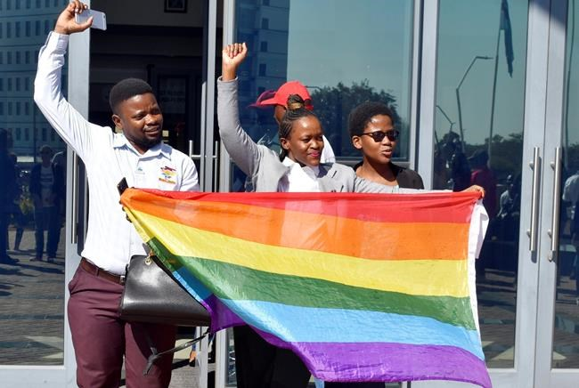 Activists celebrate outside the High Court in Gaborone, Botswana, Tuesday June 11, 2019. Botswana became the latest country to decriminalize gay sex when the High Court rejected as unconstitutional sections of the penal code that punish same-sex relations with up to seven years in prison. (AP Photo)