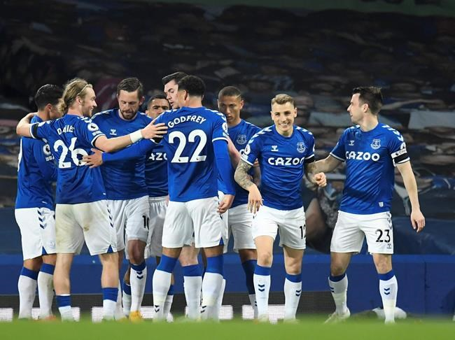 Everton's Gylfi Sigurdsson celebrates with teammates after scoring his side's second goal during the English Premier League soccer match between Everton and Tottenham Hotspur at Goodison Park in Liverpool, England, Friday, April 16, 2021. (Peter Powell/Pool via AP)