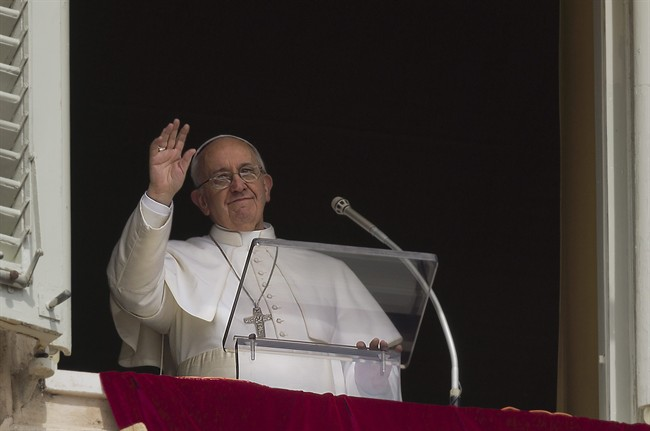 Pope Francis speaks before the Regina Coeli prayer from the window of his studio overlooking St. Peter's Square at the Vatican, Monday, April 1, 2013. (AP Photo/Domenico Stinellis)