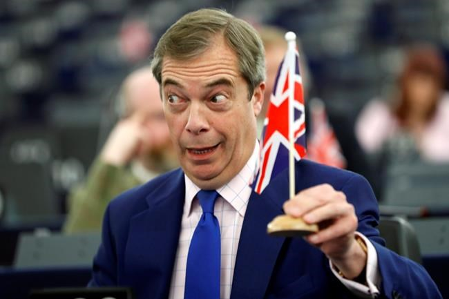 Former U.K. Independence Party (UKIP) leader and member of the European Parliament Nigel Farage holds a U.K. flag during a plenary session at the European Parliament in Strasbourg, eastern France, Wednesday, March 13, 2019. British lawmakers rejected May's Brexit deal in a 391-242 vote on Tuesday night. Parliament will vote Wednesday on whether to leave the EU without a deal. (AP Photo/Jean Francois Badias)