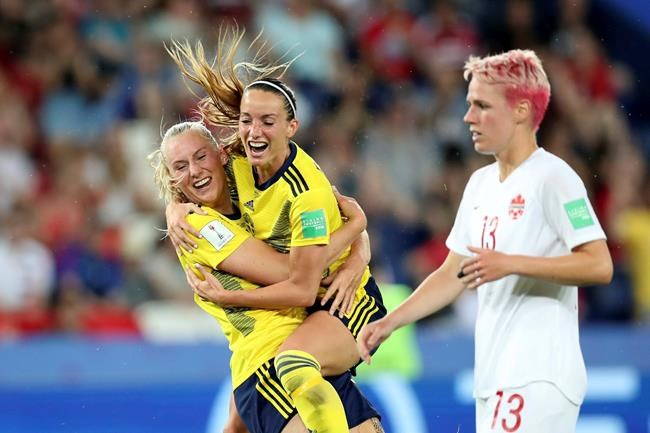 Sweden players celebrate after scoring against Canada at the Women's World Cup Monday.