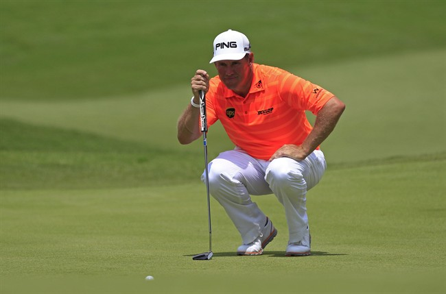 Lee Westwood of England lines up his putt on the seventh green during the third round of the Malaysian Open golf tournament at Kuala Lumpur Golf and Country Club in Kuala Lumpur, Malaysia, Saturday, April 19, 2014. (AP Photo/Lai Seng Sin)