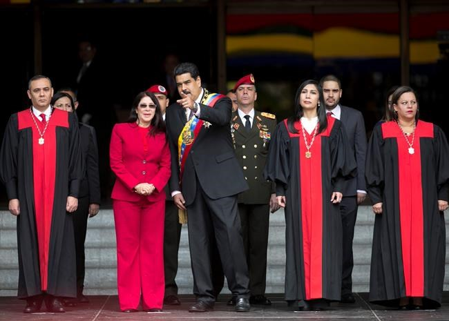 Denounced as a dictatorship, Venezuela backs down, reverses court ruling