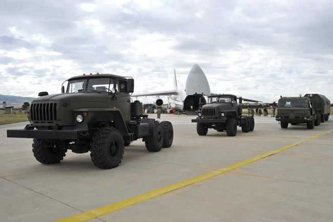 Military vehicles and equipment, parts of the S-400 air defense systems, are seen on the tarmac, after they were unloaded from a Russian transport aircraft, at Murted military airport in Ankara, Turkey, Friday, July 12, 2019. The first shipment of a Russian missile defense system has arrived in Turkey, the Turkish Defense Ministry said Friday, moving the country closer to possible U.S. sanctions and a new standoff with Washington. The U.S. has strongly urged NATO member Turkey to pull back from the deal, warning the country that it will face economic sanctions. (Turkish Defence Ministry via AP, Pool)