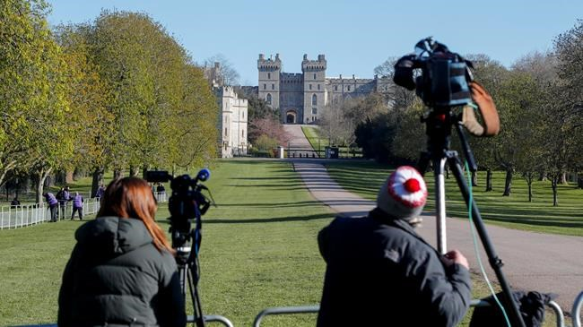 Media wait ahead of the funeral of Britain's Prince Philip in Windsor, England Saturday April 17, 2021. Philip died April 9 at the age of 99 after 73 years of marriage to Britain's Queen Elizabeth II. Coronavirus restrictions mean there will be only 30 mourners for the service, including the widowed queen, her four children and her eight grandchildren. (Frank Augstein)