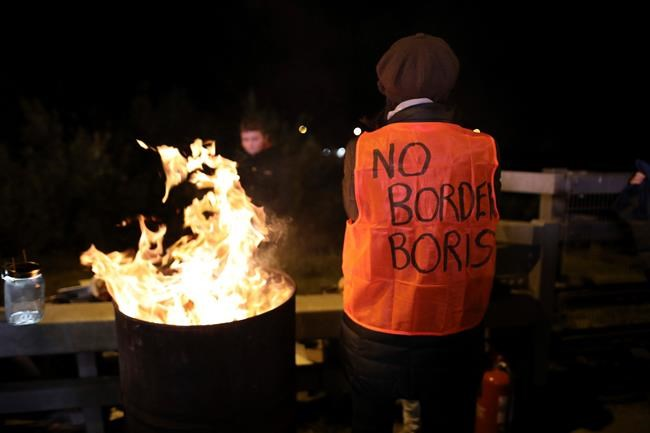 Protesters from the Border Communities Against Brexit group hold a demonstration on the Irish border on the Republic of Ireland side close to the town of Jonesborough, Ireland, Wednesday, Oct. 16 , 2019. The Border Communities Against Brexit group organised various protests at many points across the border region Wednesday. (AP Photo/Peter Morrison)