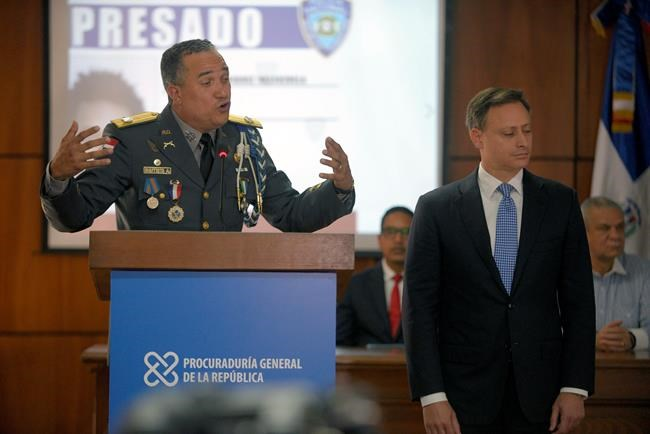 The director of the National Police, General Ney Aldrin Bautista Almonte, accompanied by the Attorney General of the Republic, Jean Alain Rodríguez, right, speaks during a press conference about the persons detained in relation to the attack on former Boston Red Sox slugger David Ortiz at the Attorney General's Office in Santo Domingo, Dominican Republic, Wednesday, June 12, 2019. (AP Photo/Roberto Guzman)