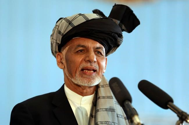 FILE - In this Sept. 28, 2019, file photo, Afghan President Ashraf Ghani speaks to journalists after voting at Amani high school, near the presidential palace in Kabul, Afghanistan. President Ghani said Tuesday, Nov. 12, his government has released three Taliban figures in effort to have the insurgents free an American and an Australian professor they abducted in 2017. (AP Photo/Rahmat Gul, File)