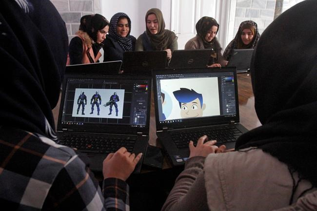 In this Monday, Jan. 22, 2018 photo, Afghan coders practice at the Code to Inspire computer training center in Herat province, western Afghanistan. The group of young Afghan women in the deeply conservative Herat province is breaking traditional barriers as the country's first female coders in an overwhelmingly male-dominated field. The game they created underscores Afghanistan's struggle to eradicate vast opium poppy fields ruled by the Taliban. (AP Photo/Ahmad Seir)