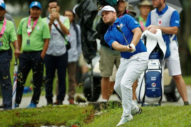 Tyrrell Hatton of Britain hits on the 8th hole during the four-ball matches of the 2018 EurAsia Cup golf tournament at Glenmarie Golf & Country Club in Shah Alam, Malaysia, Friday, Jan. 12, 2018. (AP Photo/Sadiq Asyraf)