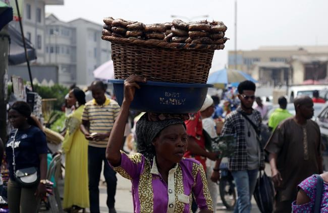 "A woman sells fish on a street in Lagos, Nigeria, Friday, Jan. 12, 2018. Africans were shocked on Friday to find President Donald Trump had finally taken an interest in their continent. But it wasn't what people had hoped for. Using vulgar language, Trump on Thursday questioned why the U.S. would accept more immigrants from Haiti and ""shithole countries"" in Africa rather than places like Norway in rejecting a bipartisan immigration deal. On Friday he denied using that language. (AP Photo/Sunday Alamba)"
