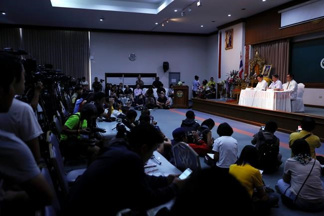 "Jesada Chokdumrongsuk, second from right, deputy director-general of the Public Health Ministry, speaks during a press conference at a hospital in Chiang Rai province, northern Thailand, Tuesday, July 10, 2018. Thai health official says rescued boys will be staying in hospital at least seven days. The Thai public health official said the eight boys rescued from a flooded cave in northern Thailand are in ""high spirits"" and have strong immune systems because they are soccer players. (AP Photo/Vincent Thian)"