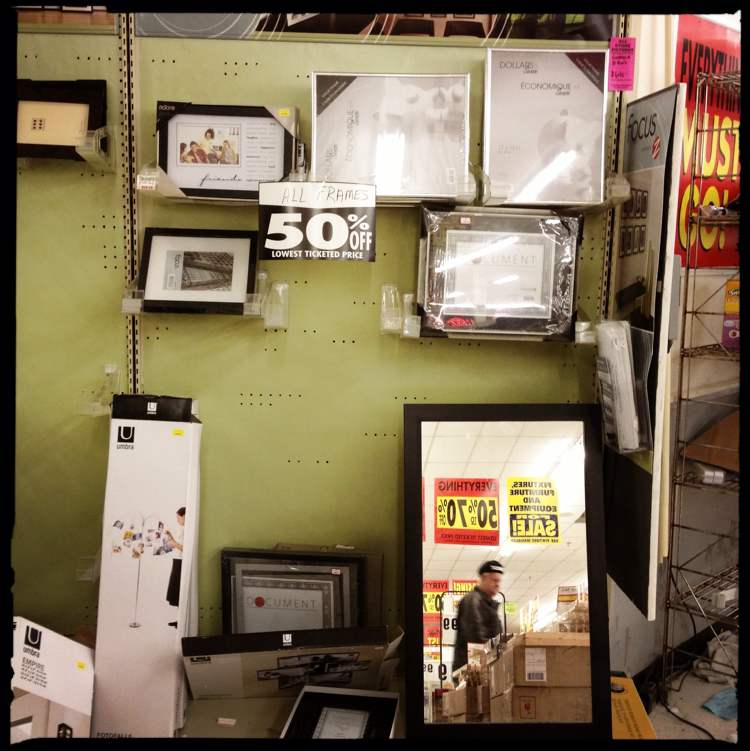 Haphazard displays of picture frames seemed to be largely ignored by shoppers.  (Mike Deal / Winnipeg Free Press)