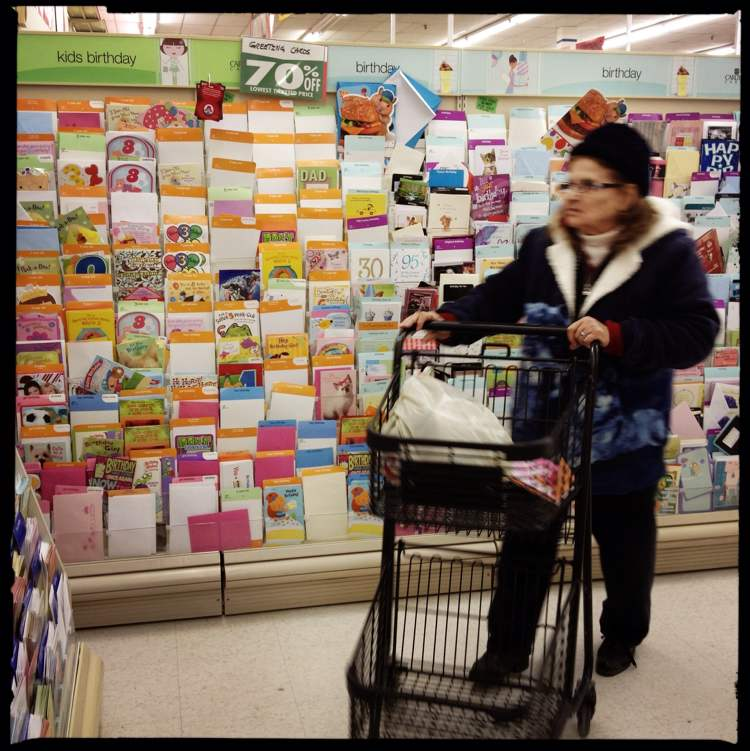 A shopper stocking up on cards.