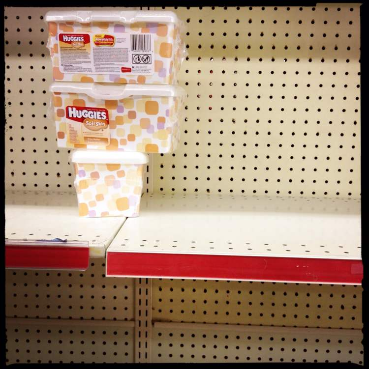 Many shelves sit mostly empty of popular products. (Mike Deal / Winnipeg Free Press)