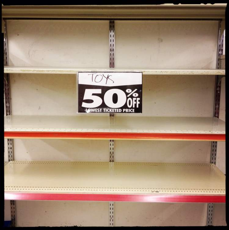 A toy shelf sits empty. (Mike Deal / Winnipeg Free Press)