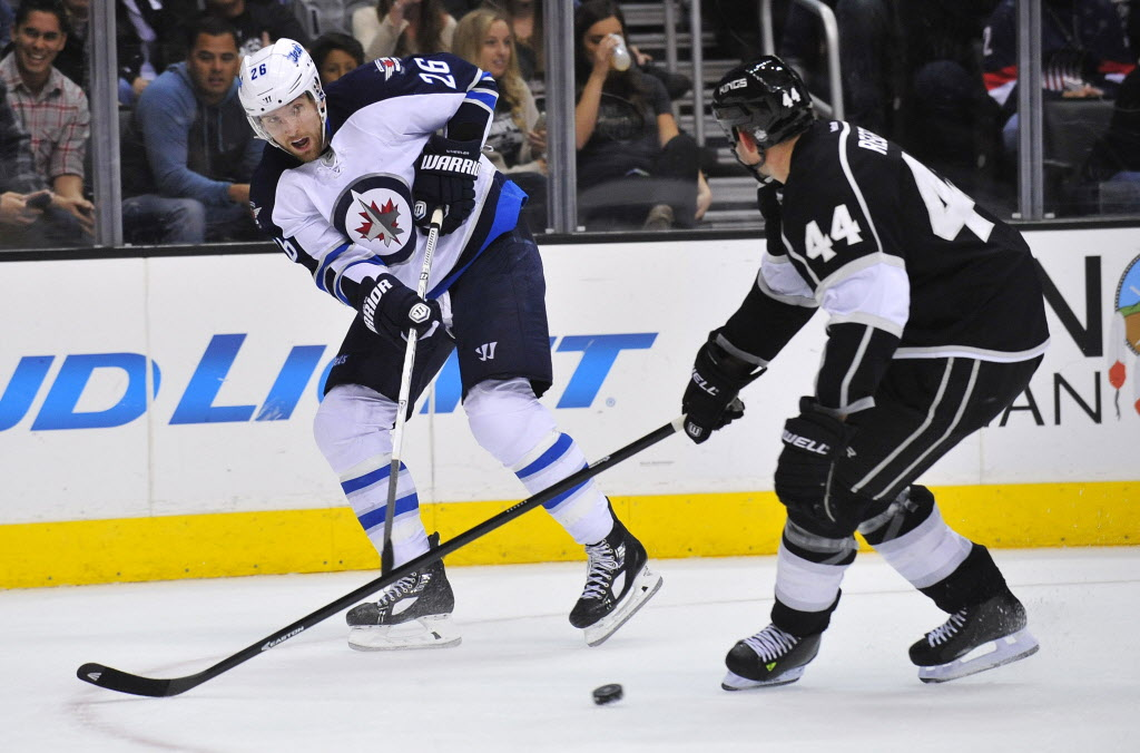 Winnipeg Jets right wing Blake Wheeler (26) passes the puck against Los Angeles Kings defenseman Robyn Regehr (44) during the second period at Staples Center. (Gary A. Vasquez / USA TODAY Sports)