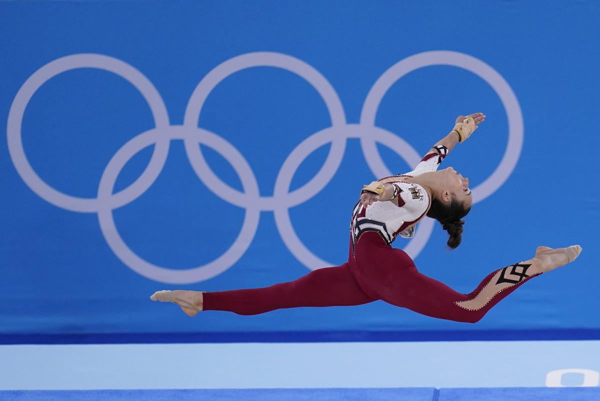 Pauline Schaefer-Betz, of Germany, performs her floor exercise routine during the women's artistic gymnastic qualifications at the 2020 Summer Olympics, in Tokyo. The German gymnastics team wore full-legged unitards that went down to their ankles, eschewing the traditional bikini cut that ends high on the hip.