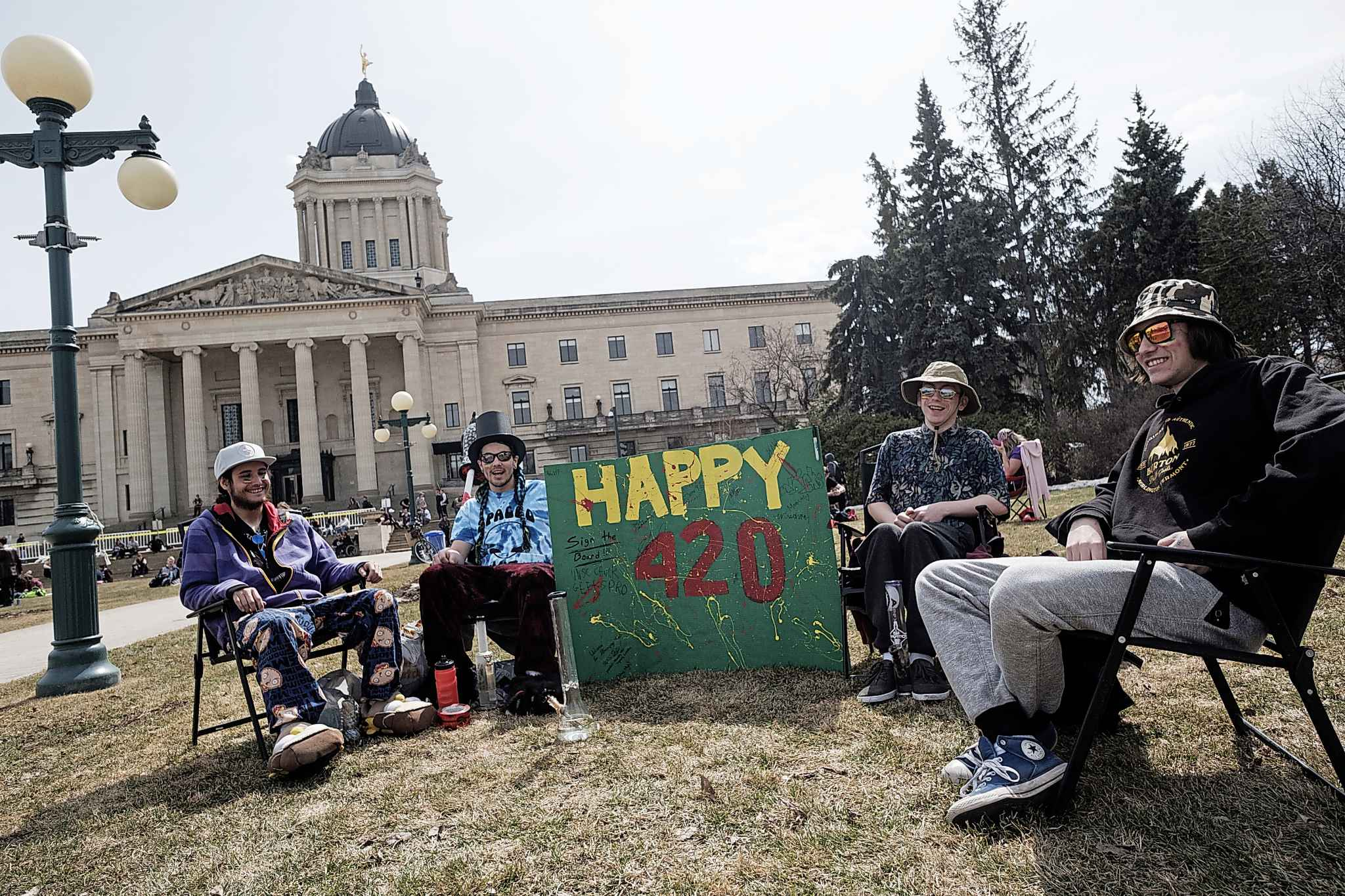 From left: Gavin Wolf, Brayden Chartrand, Dylan Johnson and Joseph Lajoie hang out during last year's 4/20 celebrations at the Manitoba Legislative Building. (Daniel Crump / Winnipeg Free Press files)