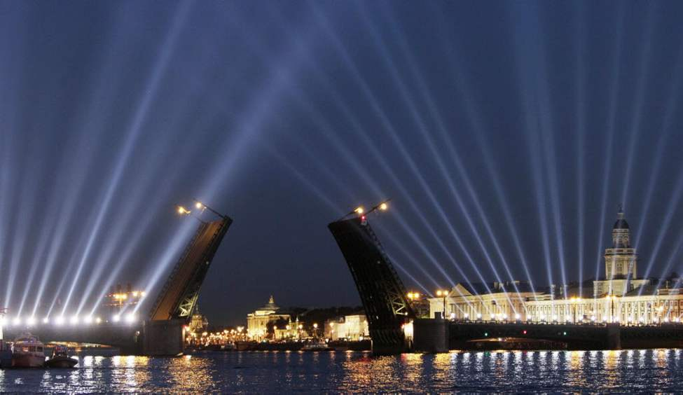 The Dvortsovy drawbridge is illuminated as it is raised across the Neva River during White Nights in St. Petersburg, Russia, early Saturday. White Nights, where it never truly gets dark, last for about a month from the middle of June till the middle of July. (AP Photo/Dmitry Lovetsky)