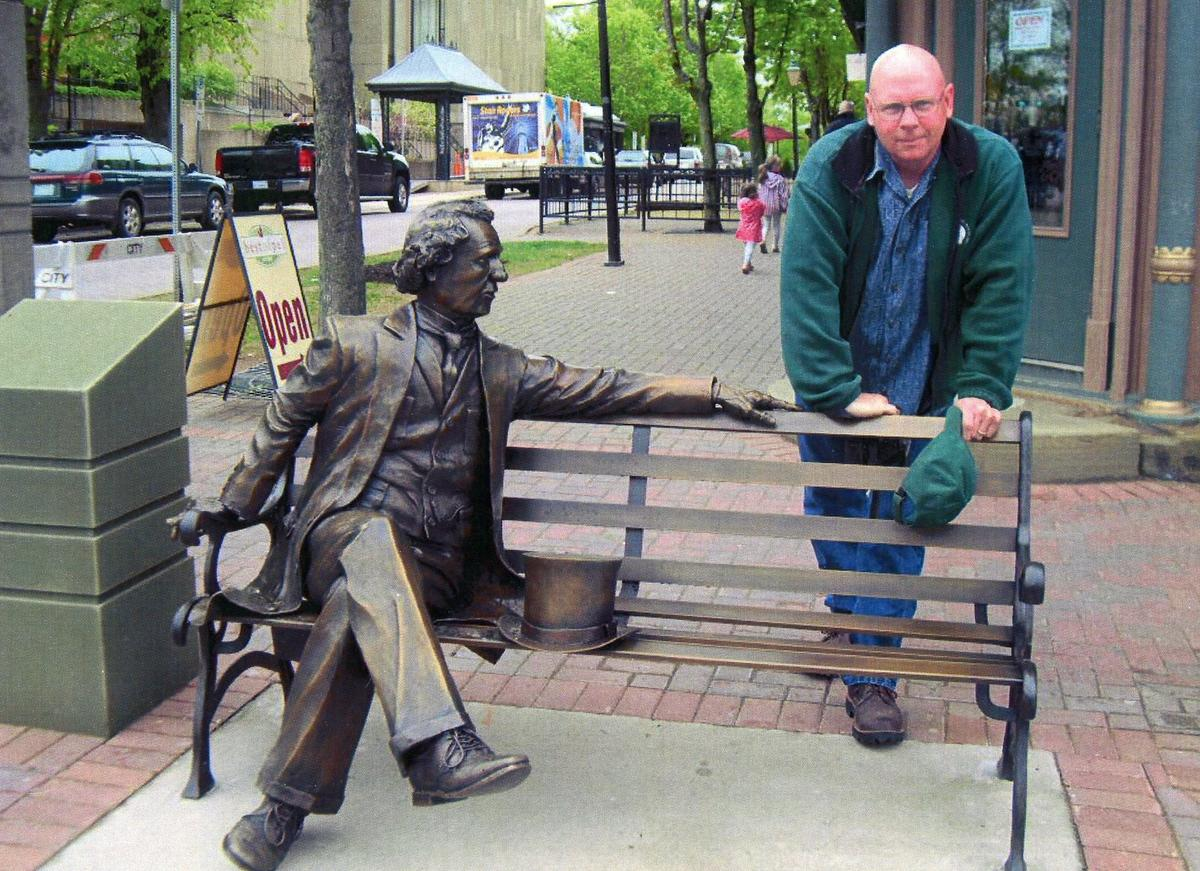 Sculptor Mike Halterman is pictured with his statue of John A. Macdonald in Charlottetown, P.E.I. (Mike Halterman)
