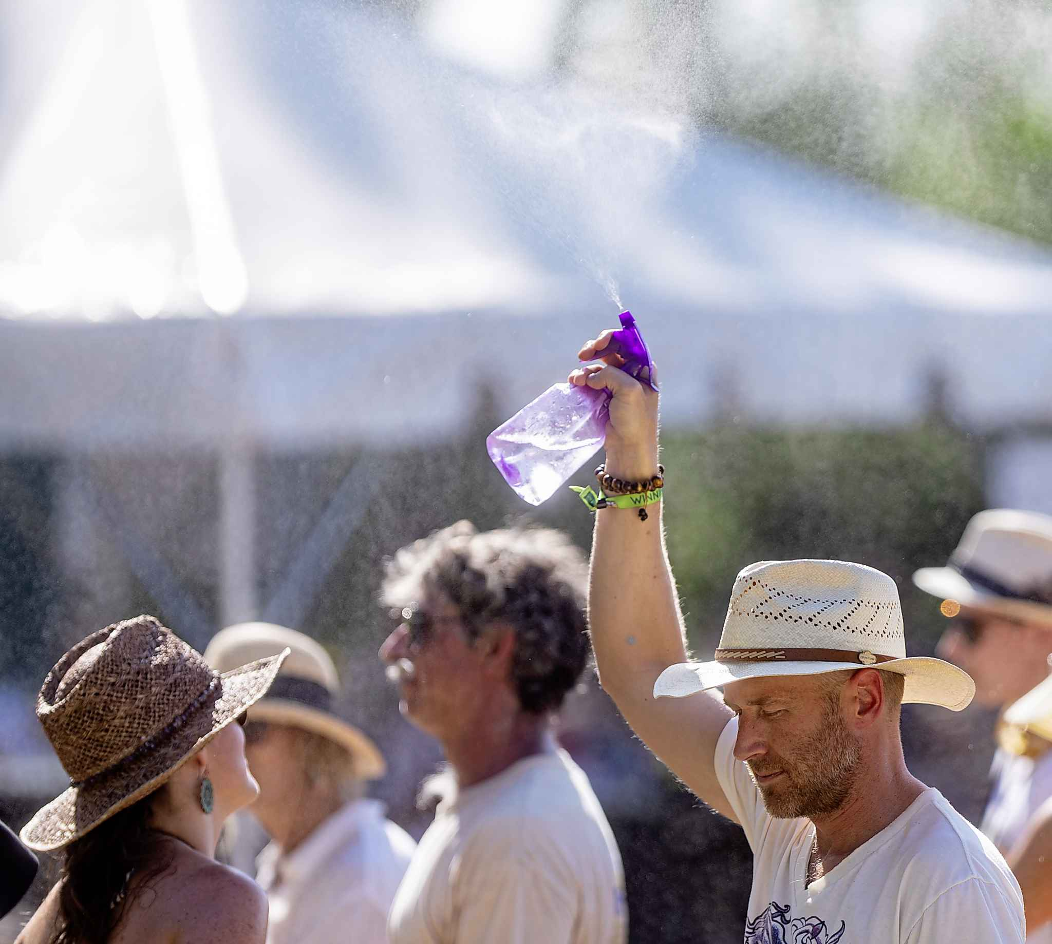 SASHA SEFTER / WINNIPEG FREE PRESS</p><p>David Stanford mists the air to cool down during the festival. Free Press staffers agreed more shade was at the daytime stage were needed. Even a misting tent would suffice.</p>
