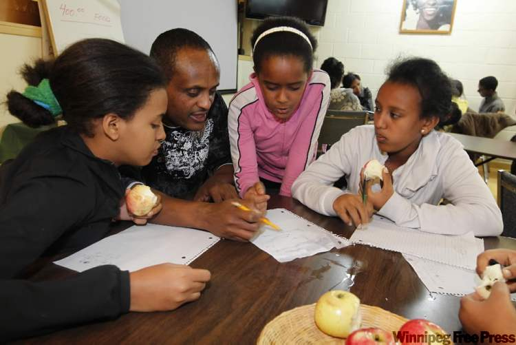 After-school programs help youngsters. From left, Simret Hanson, Mehari Negussie (tutor), Niat Mahary and Amina Omer.