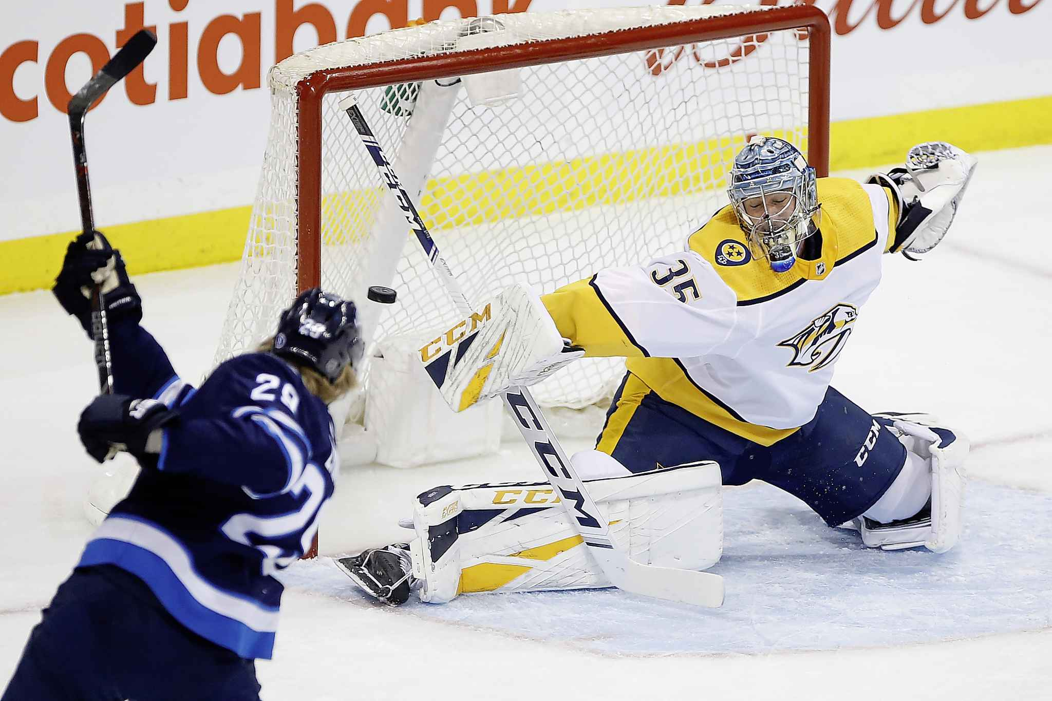 "JOHN WOODS / THE CANADIAN PRESS</p> <p>Winnipeg Jets' Patrik Laine (29) can't get the puck past Nashville Predators goaltender Pekka Rinne (35) as he makes the save during the first period.</p> <p>""></a><figcaption readability="