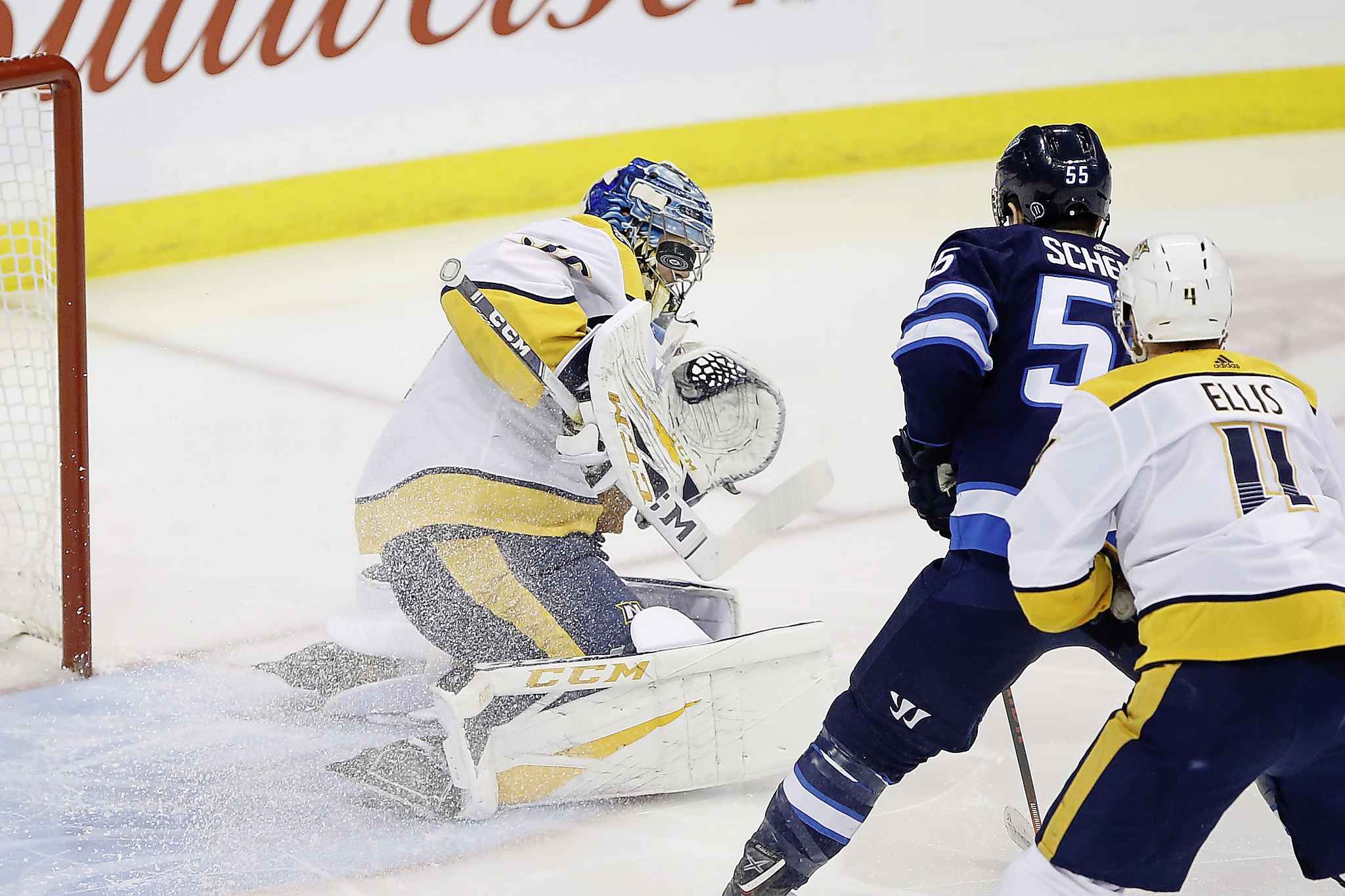 "JOHN WOODS / THE CANADIAN PRESS</p> <p>Winnipeg Jets' Mark Scheifele (55) looks for the rebound off of Nashville Predators goaltender Pekka Rinne's (35) mask as Ryan Ellis (4) defends during the first period.</p> <p>""></a><figcaption readability="