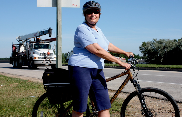 Sigrun Bailey stands near the Perimeter Highway and Raleigh Street where  she hopes an active transportation bridge will be constructed to help  extend the ... c7f9b1b89