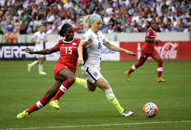 United States' Julie Johnston (8) keeps Canada's Nichelle Prince (15) from the ball during the first half of the CONCACAF Olympic women's soccer qualifying championship final Sunday, Feb. 21, 2016, in Houston. (AP Photo/David J. Phillip)