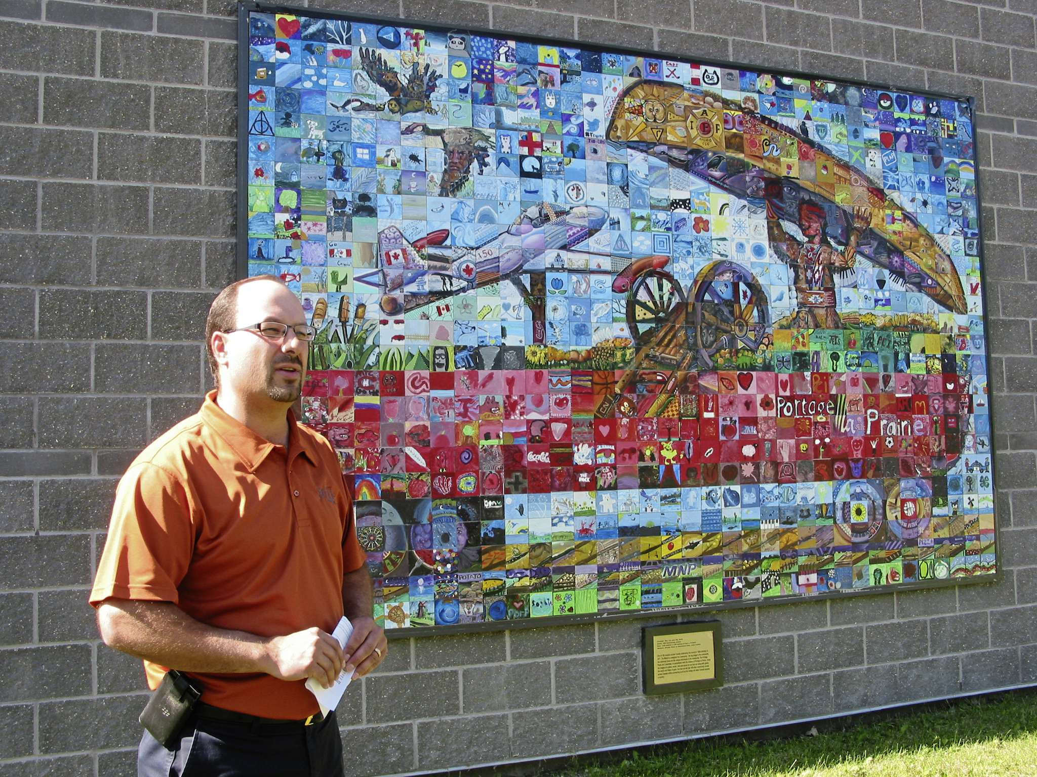 Portage la Prairie deputy mayor Brent Budz spoke at the Canada 150 mosaic unveiling at Stride Place on June 27.
