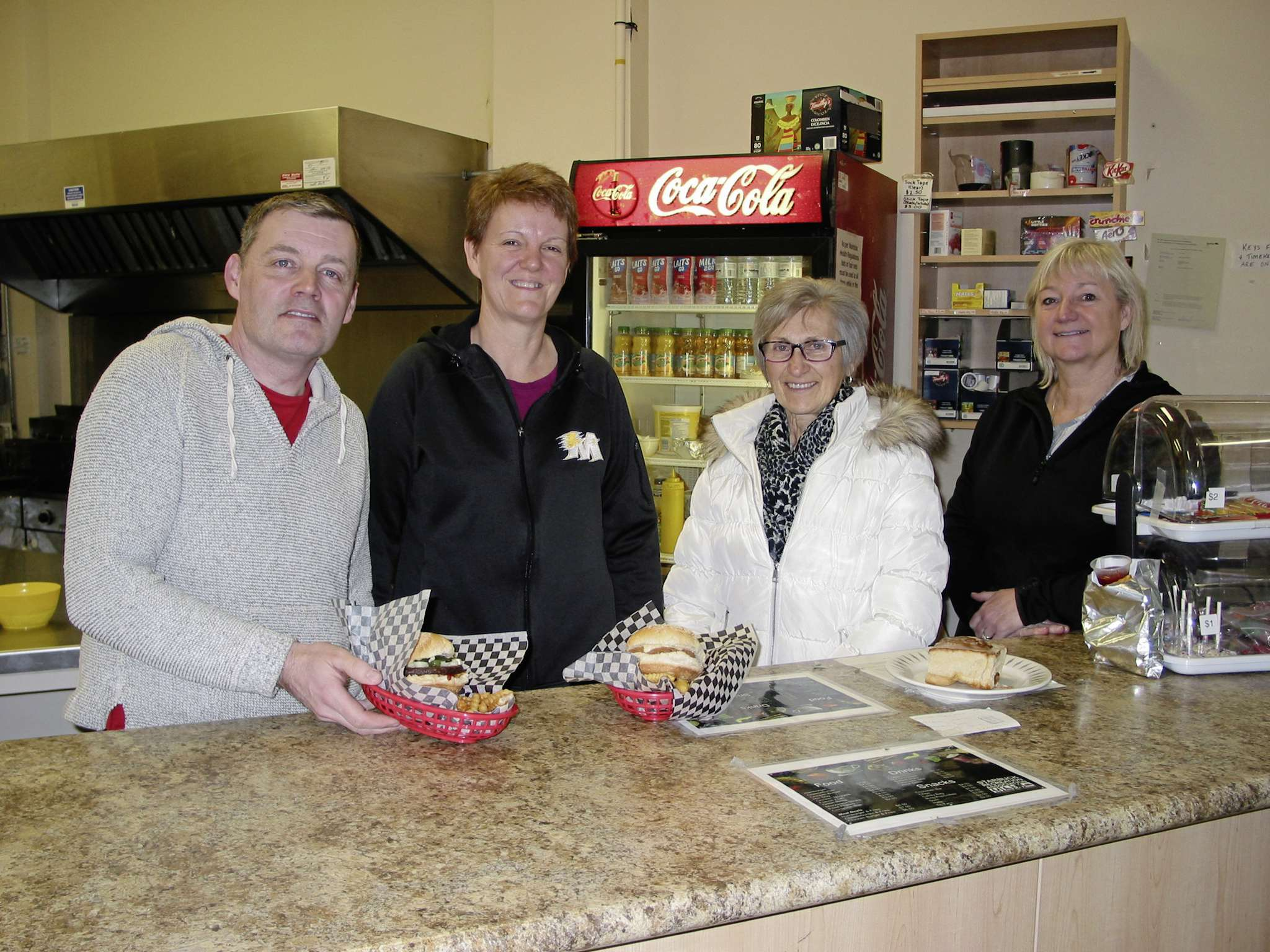 Starbuck Recreation Association volunteers (from left) Lee Kiely, Vona Guiler, Denise Vier and Mindy Hamill are shown behind the counter at the Starbuck Sports Centre's canteen which is open to the public from September to March.