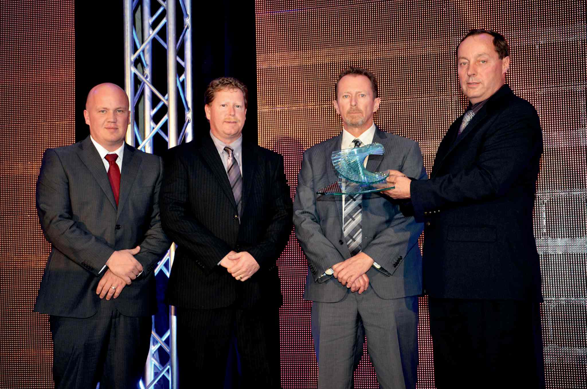 Chabot Implements received the MBiz award for rural long term achievement on Oct. 17. From left to right: Steinbach store manager Corey Chabot and brothers/partners Gilles and Bernie Chabot are presented the award by Karl Kynoch, Manitoba Pork Council chairman.