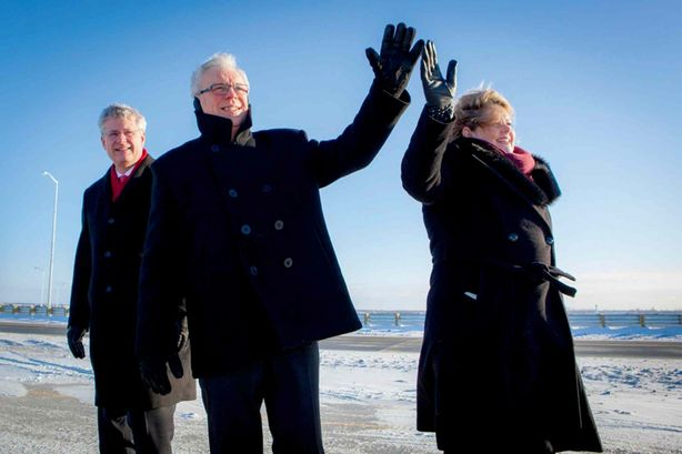 (Left) Prime Minister Stephen Harper, Premier Greg Selinger and CentrePort CEO Diane Gray officially open CentrePort Canada Way in November, 2013.