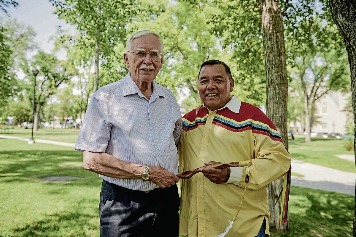 (From left) Circles For Reconciliation project coordinator Raymond Currie and Indigenous ambassador Clayton Sandy are shown with a talking stick that is used in a circle.