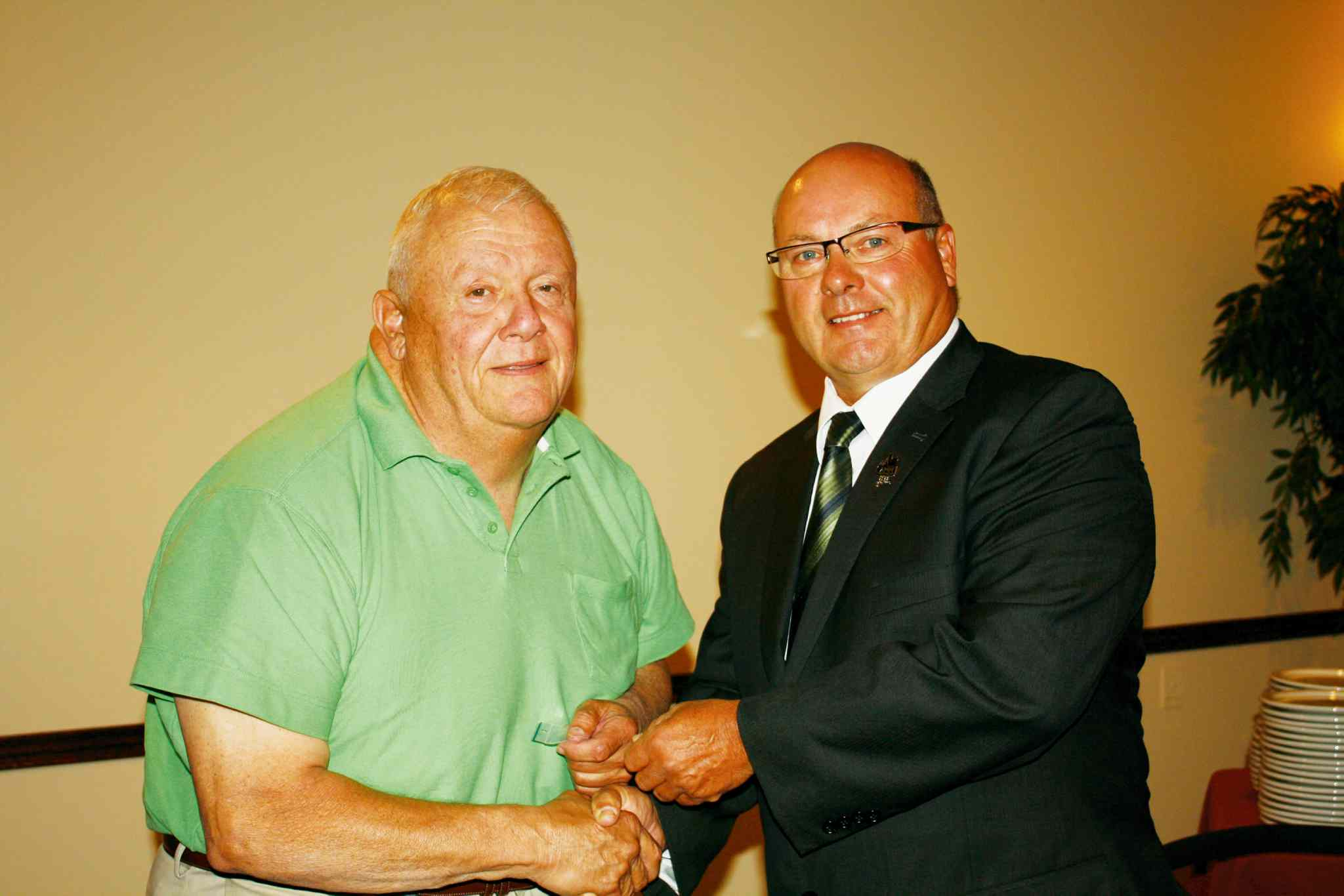 RM of Macdonald reeve Rodney Burns (left) receives an award for 25 years of service from Association of Manitoba Municipalities president Doug Dobrowolski.