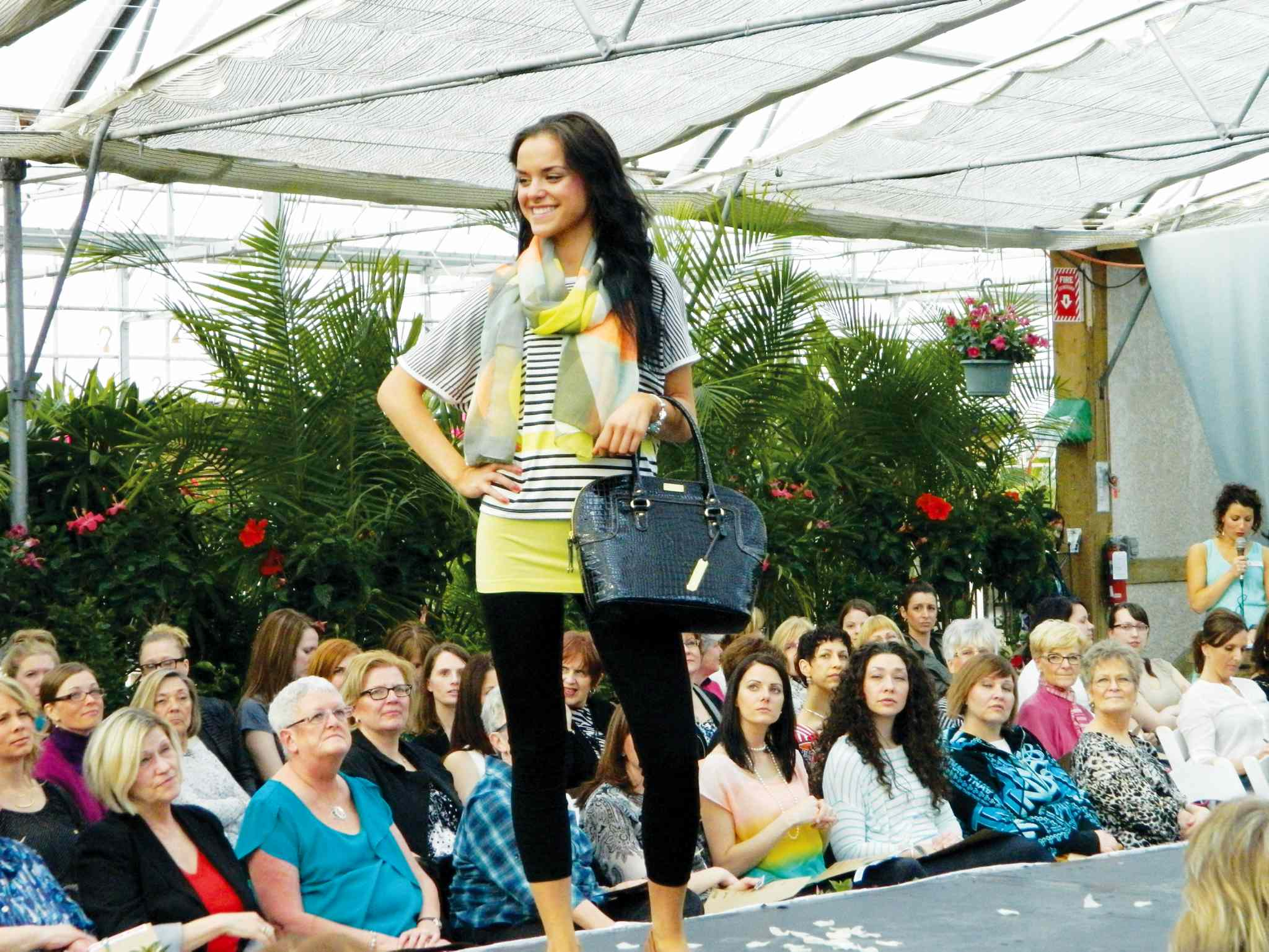 A model shows off some new fashions at one of the semi-annual Ladies' Night events held at Shelmerdine Garden Centre in support of Osborne House.