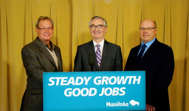 Municipal Government Minister Stan Struthers (centre) was joined in Headingley on Dec. 13 by Headingley mayor Wilfred Taillieu (left) and Association of Manitoba Municipalities president Doug Dobrowolski to announce $1.6 million in road  improvements for central Manitoba.