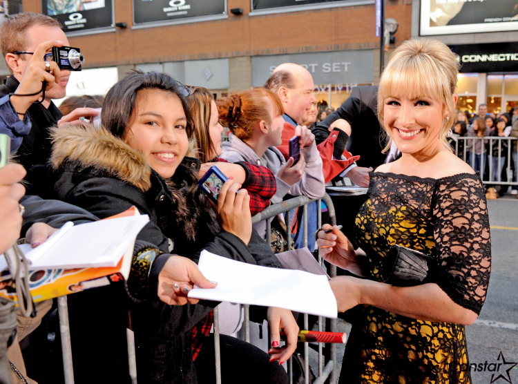 Lisa Durupt (far right) signs autographs on the Red Carpet for the 25th Gemini Awards in Toronto on Nov. 13. Durupt was nominated for her role in Less Than Kind.