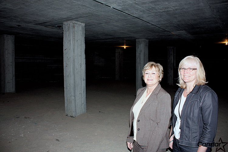 Carol Rogers, a Windsor Park Collegiate graduate of 1964, stands with the school's current principal Marilyn Thorington inside a room that until recently was believed to be a Cold War-era bomb shelter.