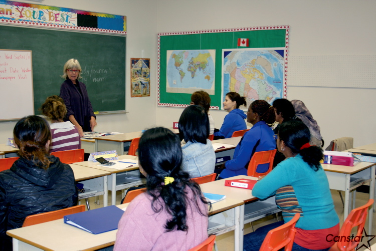 Catherine Moss, a teacher in the VM EAL program, helps newcomers who have settled in St. Vital  learn English at Glenwood School.