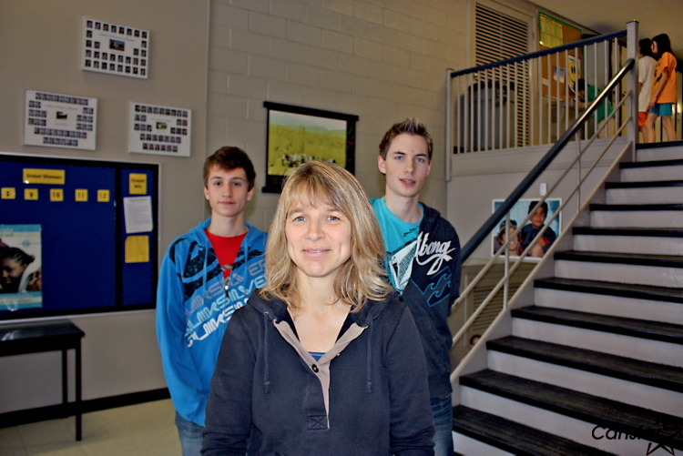 Gwen Neufeld (centre) with students Colton Sawatzky (left) and Connor Henry (right) will travel to Mexico in March to build three houses for needy families.