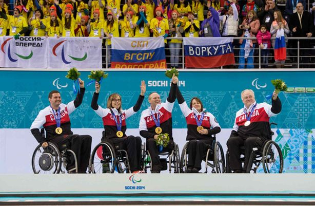 (Left) Mark Ideson, Sonja Gaudet, Dennis Thiessen of Sanford, Ina Forrest and Jim Armstrong receive their gold medals after defeating Russia in the Gold Medal Wheechair Curling match at the 2014 Sochi Paralympic Winter Games.