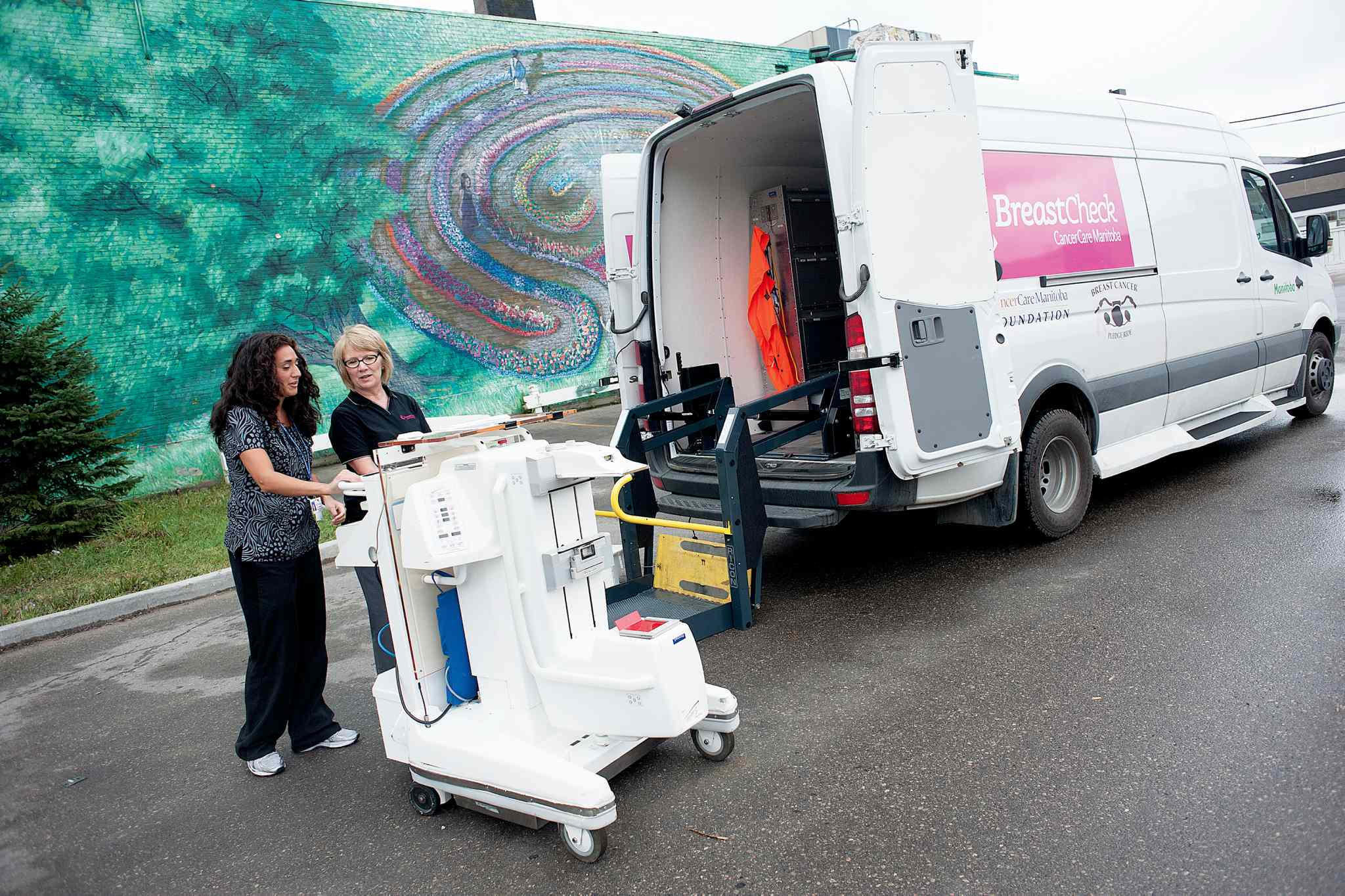 CancerCare Manitoba employees prepare equipment for a BreastCheck mobile clinic.