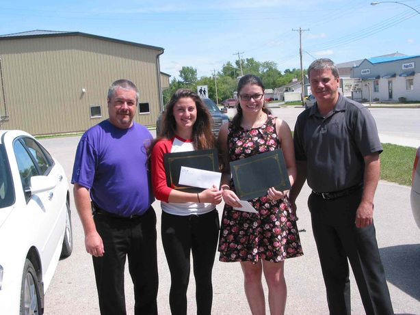 La Salle Credit Union CEO Daniel Dion (left) and credit union board president Raymond Bisson presented $500 bursaries to high school graduates Kelly Arran (second from left) and Janelle McMullan on June 18.