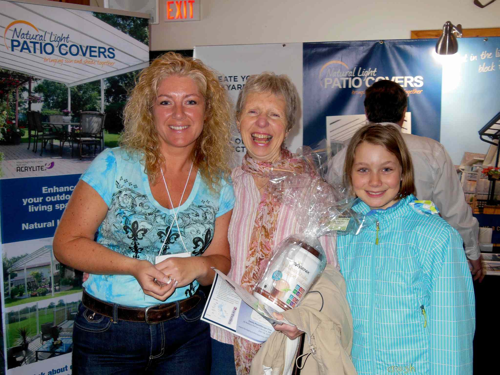 Maxene Pelletier of Isagenix (left) presented Elaine Magarrell (centre) with a door prize at the 2013 La Salle and Area Chamber of Commerce Home & Life Show. This year's show is being held on May 3 in the new LSCU Complex.