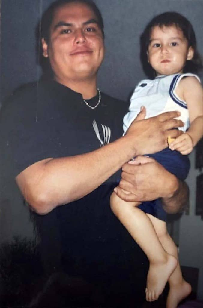 Will Ahmo, pictured holding son Emory, died while an inmate at Headingley Correctional Institution on February 14.
